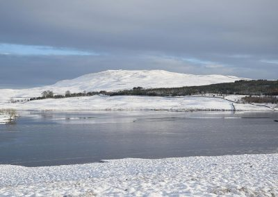 Loch Urr from the west shore looking South East to Castramon Hill. It is estimated that 3 or 4 turbines (up to 250m) will be visible.